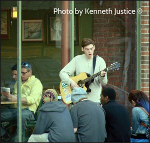 This guy sat down with his guitar and within 10 minutes he had a group of strangers sitting around him