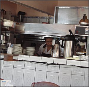 A local Tica preparing a typical Costa Rican breakfast of Casados