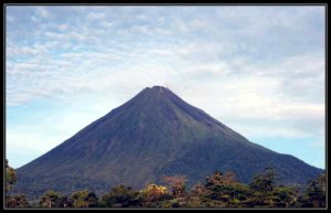 Arenal Volcano can be seen from the street where the coffee shop is at